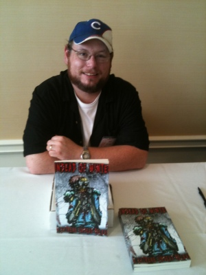 At Horrorfind 2011 at the signing table after my reading.  Only one book and if I did it today it would be over twenty.